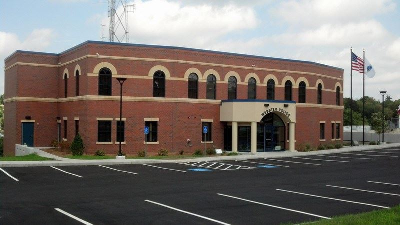 Police Station Headquarters two story brick building and parking lot